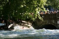 Start slide show: Eisbach river surfers in downtown Munich