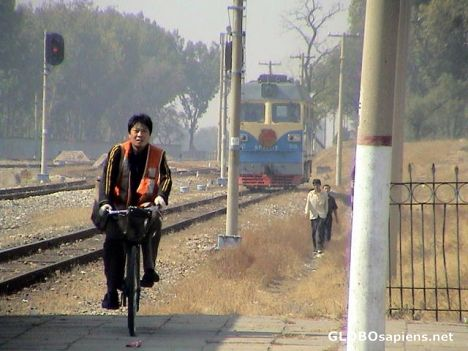 train driver on a bike