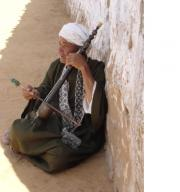 Nubian Man singing to pass his time.