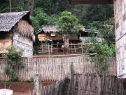 White Karen Village with house arranged in communal compounds of 3 and 4.