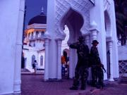 the mosque and its guards in arm.