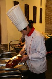 Cook slicing the Peking Duck