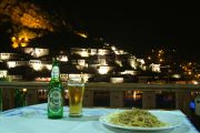Spaghetti carbonara at the Antigoni overlooking old Berat illuminated at night.