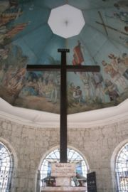 Details of ceiling paintings inside the hexagonal edifice and the replica of Magellan's Cross