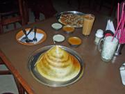 Dosa, a crispy rice pancake in the shape of a pointed hat