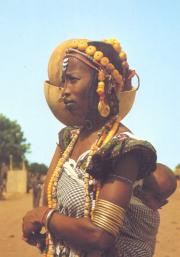 Young Peulh girl with her baby