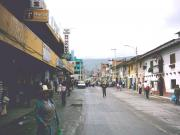 A street in Huaraz with a Semana Santa parade coming down the street.