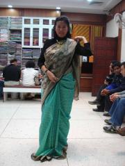 A happy tourist trying the sarees! And yes...she bought it!