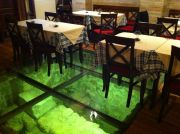The lobby bar of the Stari Grad Hotel, glass floor revealing old foundations.