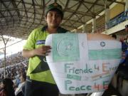 message for harmOny between India n Pakistan-- a kid with a poster at the Gaddaffi stadium, Karachi