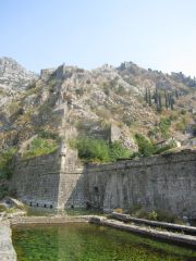 From outside the moat, the citys walls zig-zag up to the fort in the top right