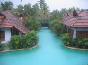 A view of the meandering pool villas