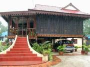 A Traditional Malay house next to Padang Beras Terbakar