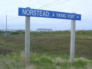 "L'Anse aux Meadows and the sign ""NORSTEAD: A Viking Port""."