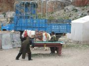 Tibetans, their horse, a truck and a pool table.