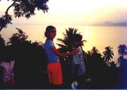 Daughter Eliza and Nephew Jason watching the sun set over Lake Taal