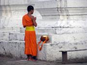 Monk deep in prayer.