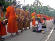 Monks collecting alms.