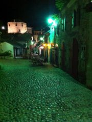 One of old Mostar's main streets at night, near the Marshall Pub.