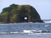Bantay Abot in Gaoa. A rock with a hole in the midst of the sea.