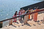 the devotees going down the ghats, to perform their ablutions.