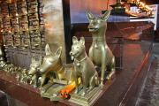Inside is a wooden shrine guarded by bronze temple dogs. Dogs are considered sacred.
