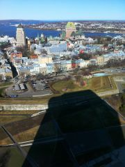 The shadow of the Hilton Hotel and the Upper Old Town of Quebec City.