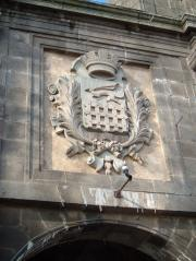 The town crest above one of the massive gates