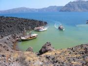 Boats berthing at volcano island