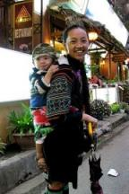 Black H'mong Vendor Girl and Child in Front of Fansipang Restaurant