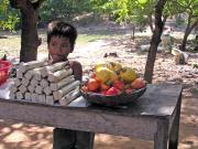 Cashew nut seller. I never knew that the fruit were so large for but one nut.