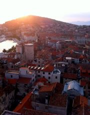 The view of sunset over the old part of Split seen from the bell tower of the cathedral.