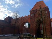 One of the gates adjacent to the ruins of the Teutonic Knights' Castle and the Hotel 1231