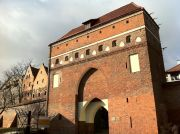 The Monastery Gate (pol. Brama Klasztorna) in the southern fragment of the Old Town city walls.