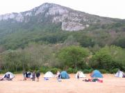 Tents at the foot of a small mountain