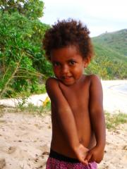 Little girl from the small village on the beach to the north of Octopus
