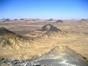 Volcanic mountains have sprinkled iron ore in a thin layer over the Black Desert