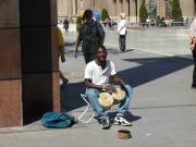 African tourist playing JOTA alone in Plaza Pilarica